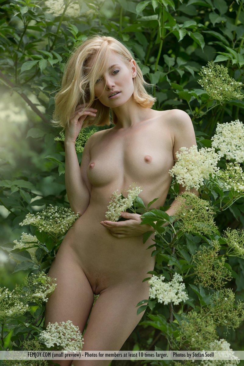 Blonde girl bent over nude